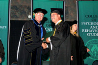 Argosy Commencement Receiving Diploma 2012